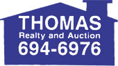 Thomas Realty logo
